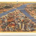 Color postcard of downtown Pittsburgh and rivers intersecting