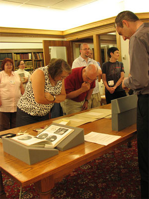 People reading the special collections in the Amherst College archives