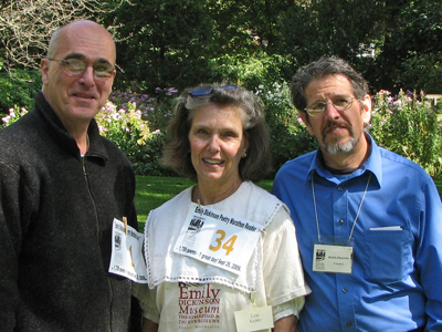 Three smiling volunteers at the Amherst poetry fest, 2009