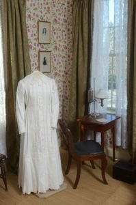 Emily's Iconic white dress on display in her room today