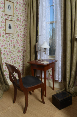 chair and small writing desk in Emily's bedroom