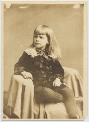 "black and white photograph of a young Gib seated and wearing his ""little lord Fauntleroy suit"""