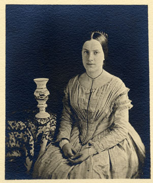 black and white photograph, of young woman seated