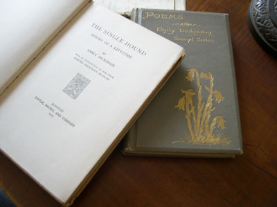 """The Single Hound, Poems of a Lifetime"" (left) by Emily Dickinson, edited by Martha Dickinson Bianchi, and ""Poems"" (right) by Emily Dickinson edited by Mabel Loomis Todd and Thomas Wentworth Higginson"