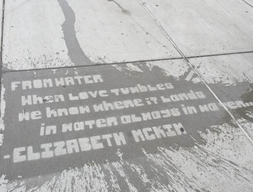 Lettering on a sidewalk washed by rain