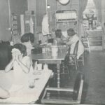 black and white photo of incarcerated women playing cards.