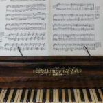 Homestead piano and sheet music