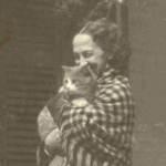 Lavinia Dickinson holding a cat