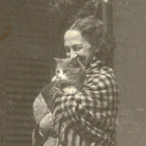 Lavinia Dickinson holding a cat