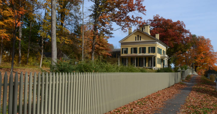 Emily Dickinson homestead, a yellow house, viewed from the sidewalk in autumn