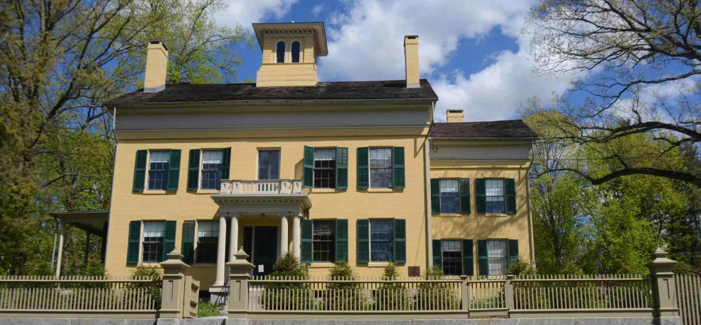 The Dickinson homestead, a yellow house with black shutters