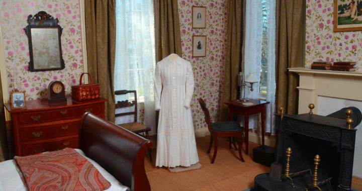 Emily Dickinson's white dress on a stand in her bedroom