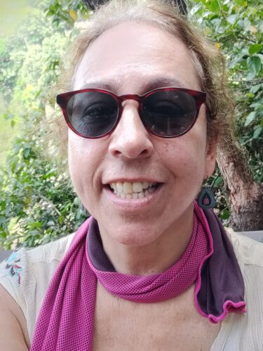 Cheryl J. Fish pictured in sunglasses smiling at the camera