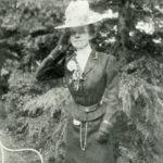 Martha Dickinson Bianchi in garden
