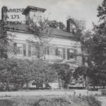 Black and white postcard depicting a photograph of the Dickinson Homestead