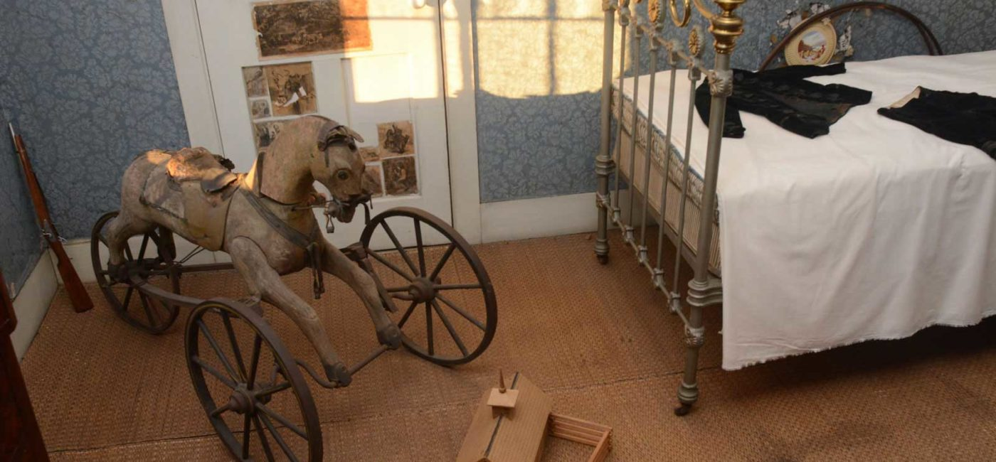 A wooden riding horse and other toys